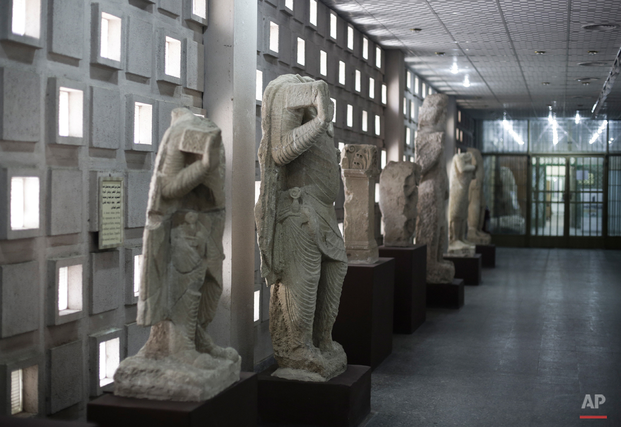 In this Sunday, March 13, 2016 photo, stone figures from the ancient site of Hatra line a corridor of the Iraq National Museum the Iraqi capital. They remain some of the only treasures from Hatra, which the Islamic State group destroyed along with several ancient sites in Iraq and Syria as part of its campaign to cleanse the territory it controls of items the extremists deem as non-Islamic. After the destruction wreaked on archaeological sites by Islamic State group, the collections at the Iraqís National Museum in Baghdad have become even more important. Itís now one of the places you can find relics from ancient cities that fell into the extremistsí hands. (AP Photo/Maya Alleruzzo)