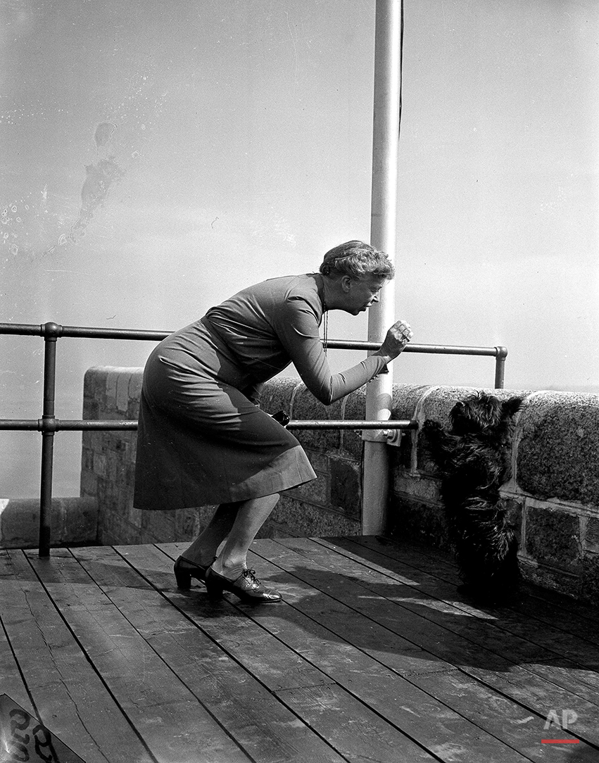 Fala, pet Scottie Terrier of President Roosevelt, goes through his bag of tricks for first lady Eleanor Roosevelt on the terrace of the Citadel, historic fortress of Quebec City, Canada, Sept. 13, 1944. The Roosevelts and British Prime Minister Winston Churchill are in Canada for a military conference. (AP Photo/Murray Becker)