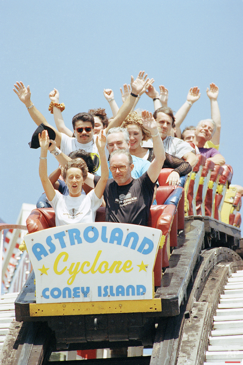 Jackqueline and Barry Norman, foreground, of England, join members of the American Coaster Enthusiasts for a ride on the Cyclone roller coaster at Astroland Park in Coney Island, in the Brooklyn borough of New York, Aug. 30, 1992. (AP Photo/Alex Brandon)