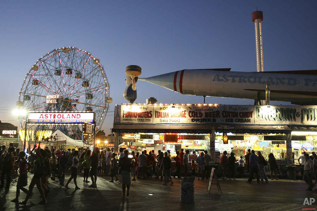The entrance to Astroland Park is seen from the boardwalk at night at Coney Island, N.Y., Sunday, Sept. 7, 2008.  (AP Photo/Seth Wenig)