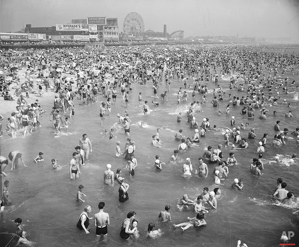 This general view from the Steeplechase Pier shows part of the crowded beach at Coney Island in Brooklyn, N.Y., Aug. 28, 1948. (AP Photo)