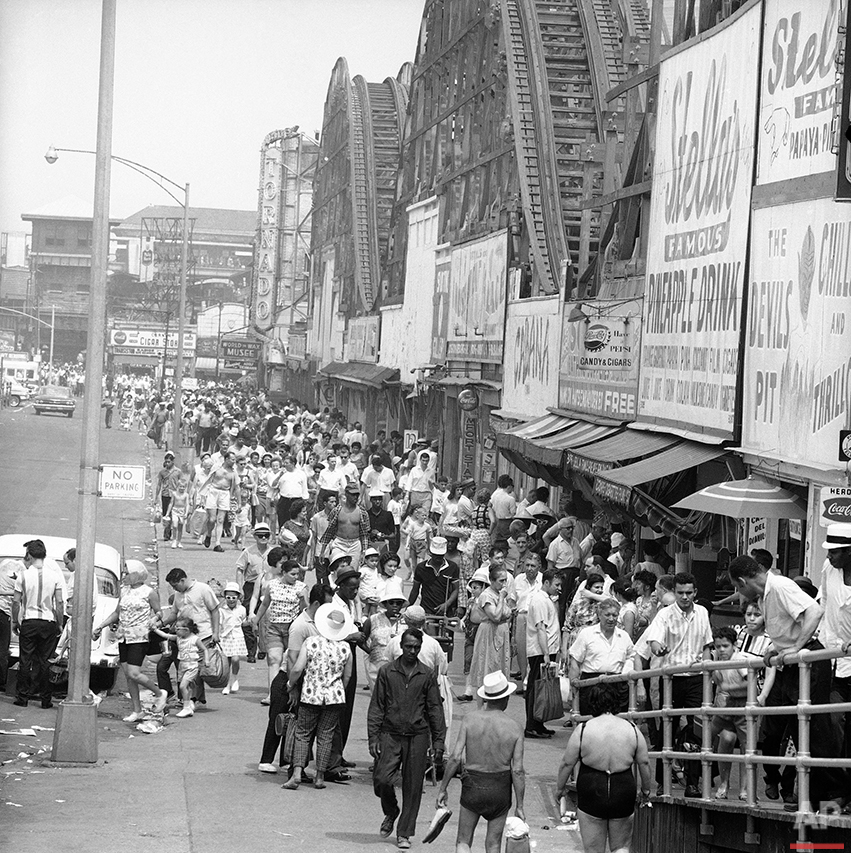 Mobs of people disgorge from the Surf Ave. subway station at Coney Island, New York on July 29, 1963, head for the beach and relief from a sweltering heat wave that has gripped the eastern seaboard for days. (AP Photo/John Lindsay)