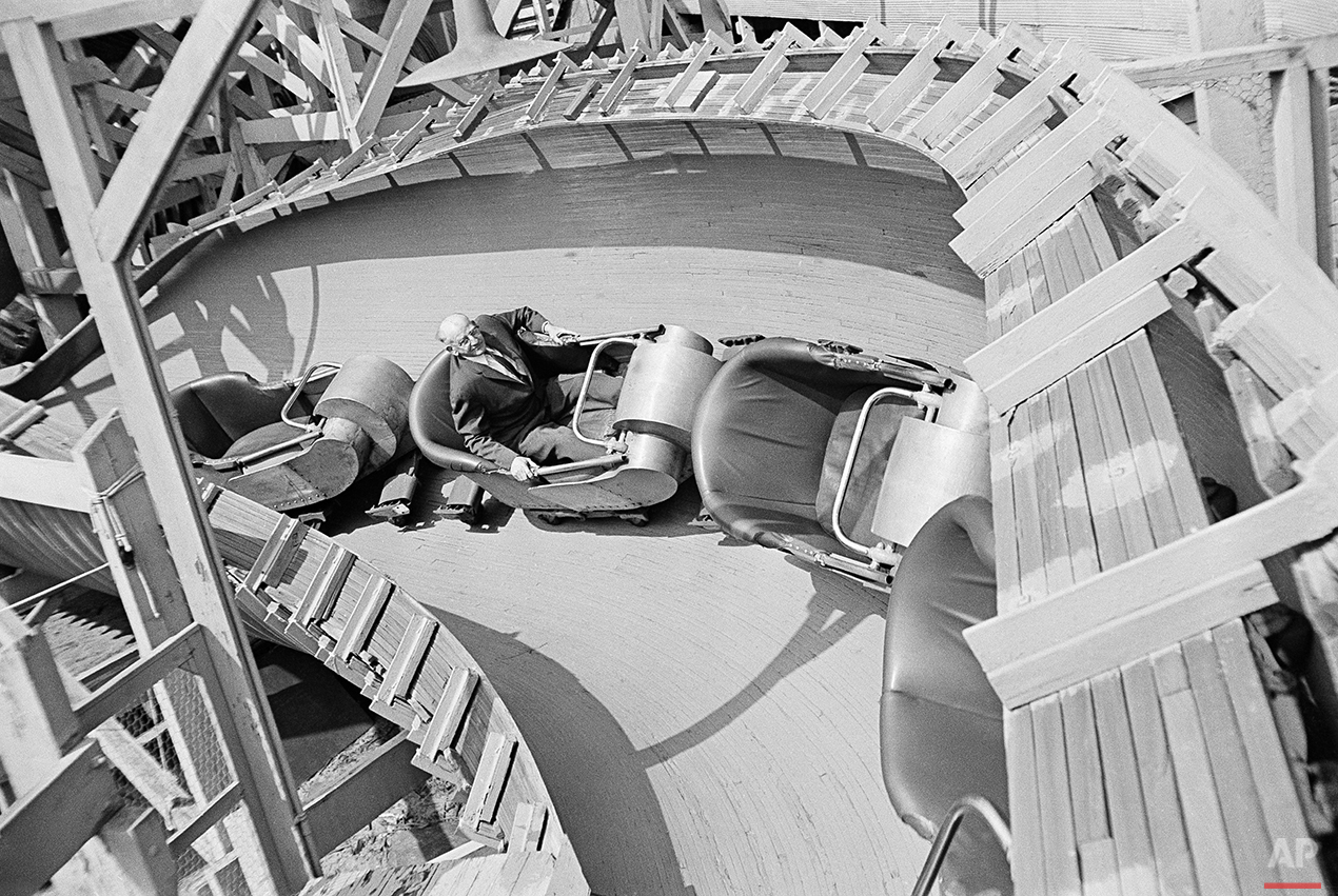 Bill Olsen, of Brooklyn, a New York elevator inspector, is shown on the job inspecting rides at Coney Island in the Brooklyn borough of New York, 1964, before the start of the summer season. (AP Photo)
