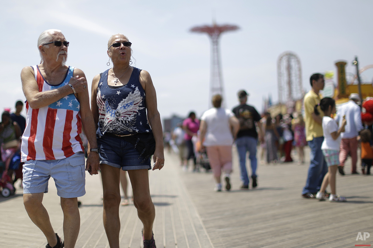 Don, left, and Angela Boerem, of Queens, take a stroll on the Coney Island boardwalk, Friday, July 3, 2015, in the Brooklyn borough of New York. (AP Photo/Mary Altaffer)