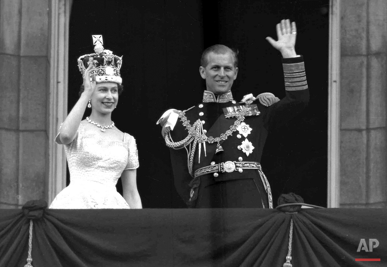 This is a June. 2, 1953 photo of Britain's Queen Elizabeth II and Prince Philip, Duke of Edinburgh, as they wave to supporters from the balcony at Buckingham Palace, following her coronation at Westminster Abbey. London. (AP Photo/Leslie Priest)