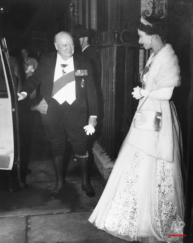 British Prime Minister Sir Winston Churchill, wearing knee breeches, garter and garter sash, holds car door for Queen Elizabeth II after being host at a farewell dinner at No. 10 Downing Street in London on April 5, 1955, for his Queen and for leaders in the country's political circles. It is believed that Churchill will step down as prime minister and that he will be succeeded by his protege, Sir Anthony Eden, now foreign secretary. (AP Photo/ROTA)