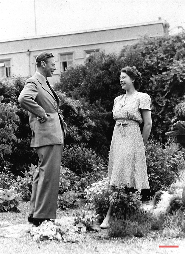 Britain's Princess Elizabeth, later Queen Elizabeth II, enjoys a joke with her father King George VI, in the grounds of the Royal Lodge, Windsor, England, Aug. 20, 1946.  (AP Photo)