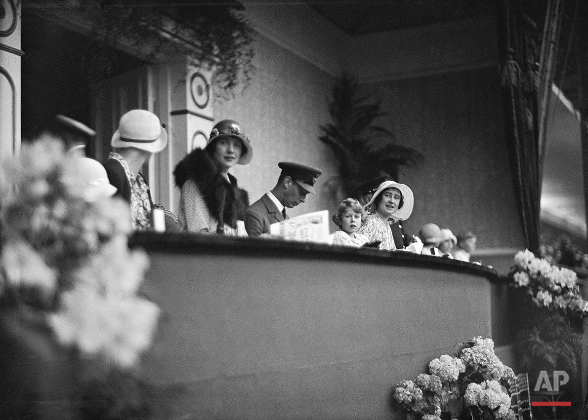 Britain's Princess Elizabeth with her parents Prince Albert and Lady Elizabeth Bowes Lyon, The Duke and Duchess of York in the RoyalBbox  for the Royal Tournament at Olympia, London on June 5, 1931. (AP Photo/Staff/Putnam)