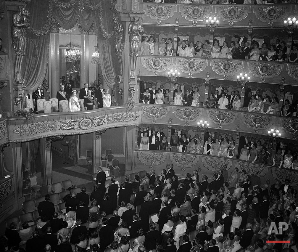 The royal box containing Queen Elizabeth II of Great Britain,  the Duke of Edinburgh and President  Francisco Craveiro Lopes, and his wife Berta, of Portugal inside the Sao Carlos Opera House, in Lisbon, Portugal, on Feb. 19, 1957. The British royal couple were attending a gala performance in their honour, held on this the second day of their state visit to Portugal. (AP Photo)