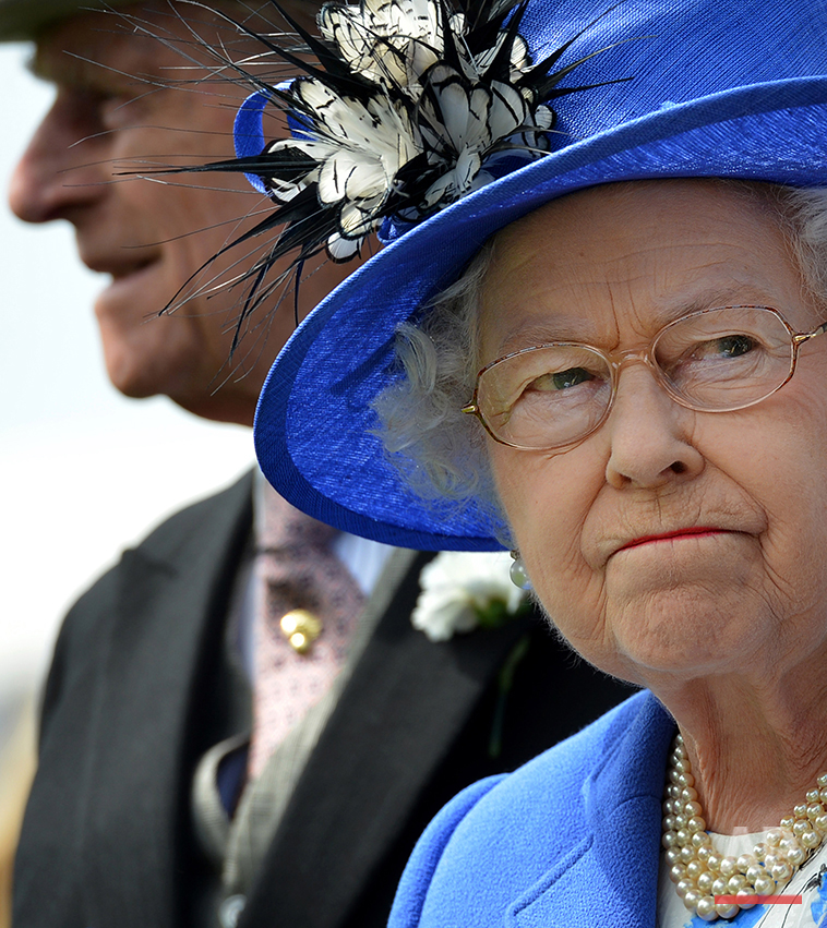 Britain's Queen Elizabeth II  and Prince Philip, left, inspect the horses in the parade ring before the Derby race at Epsom Derby, Epsom, southern England, Saturday June 2, 2012 the first official day of the Queen's Diamond Jubilee celebrations. Britain is marking Queen Elizabeth II's 60 years on the throne with a four-day holiday weekend of ceremony, symbolism and street parties.  (AP Photo/Ben Stansall, Pool)