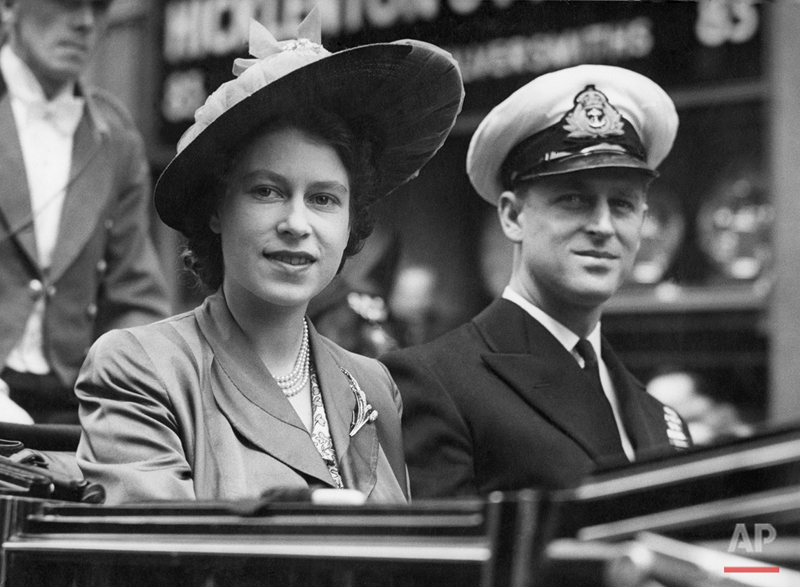 Britain's Princess Elizabeth smiles as she is seen with the Duke of Edinburgh, in an open Landau, as they drive from the Guildhall, in London, on June 8, 1948, where he was made a Freeman of the City of London. The Royal couple are going to the Mansion House for luncheon with the Lord Mayor of London. (AP Photo/Priest)