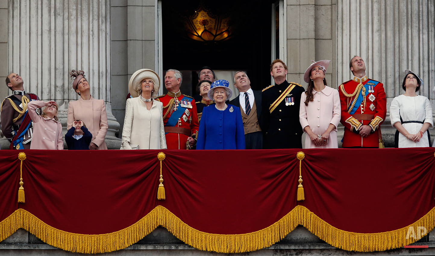 """Britain's Queen Elizabeth II, centre, surrounded by members of her family, watch a Royal Air Force fly pass by, on the balcony of Buckingham Palace, during the Trooping The Colour parade, in London, Saturday, June 15, 2013. Queen Elizabeth II celebrated her birthday with traditional pomp and circumstance _ but without her husband by her side.  Prince Philip remains in the hospital, recovering from exploratory abdominal surgery. The queen invited her cousin, the Duke of Kent, to accompany her in a vintage carriage. Other royals — including Prince Harry and the Duchess of Cambridge — joined in the celebration Saturday. More than 1,000 soldiers, horses and musicians are taking part in the parade known as """"Trooping the Color,"""" an annual ceremony. From left, Prince Edward, the Earl of Wessex, Lady Louise, James, Viscount Severn, Sophie, the Countess of Wessex, Camilla, The Duchess of Cornwall, Prince Charles, Anne, the Princess Royal, Timothy Laurence,  Prince Andrew, Duke of York, Prince Harry, Kate, The Duchess of Cambridge, Prince William, Duke of Cambridge and Princess Eugenie.  (AP Photo/Sang Tan)"""