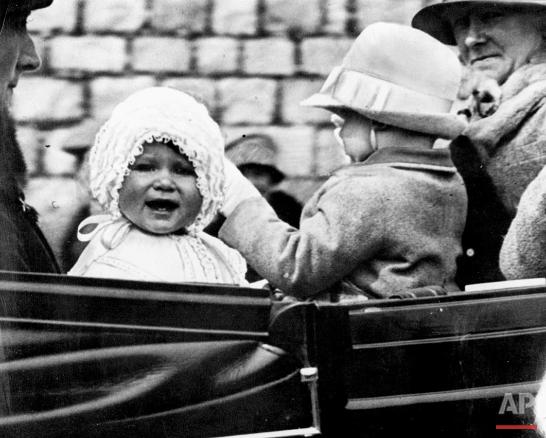 In this 1927 photo, Princess Elizabeth is taken for a ride in the grounds of Windsor Castle, with her cousin, the honourable Gerald Lascelles, right, son of Princess Royal. Britain's Queen Elizabeth celebrates her 90th birthday on Thursday, April 21, 2016. (AP Photo)