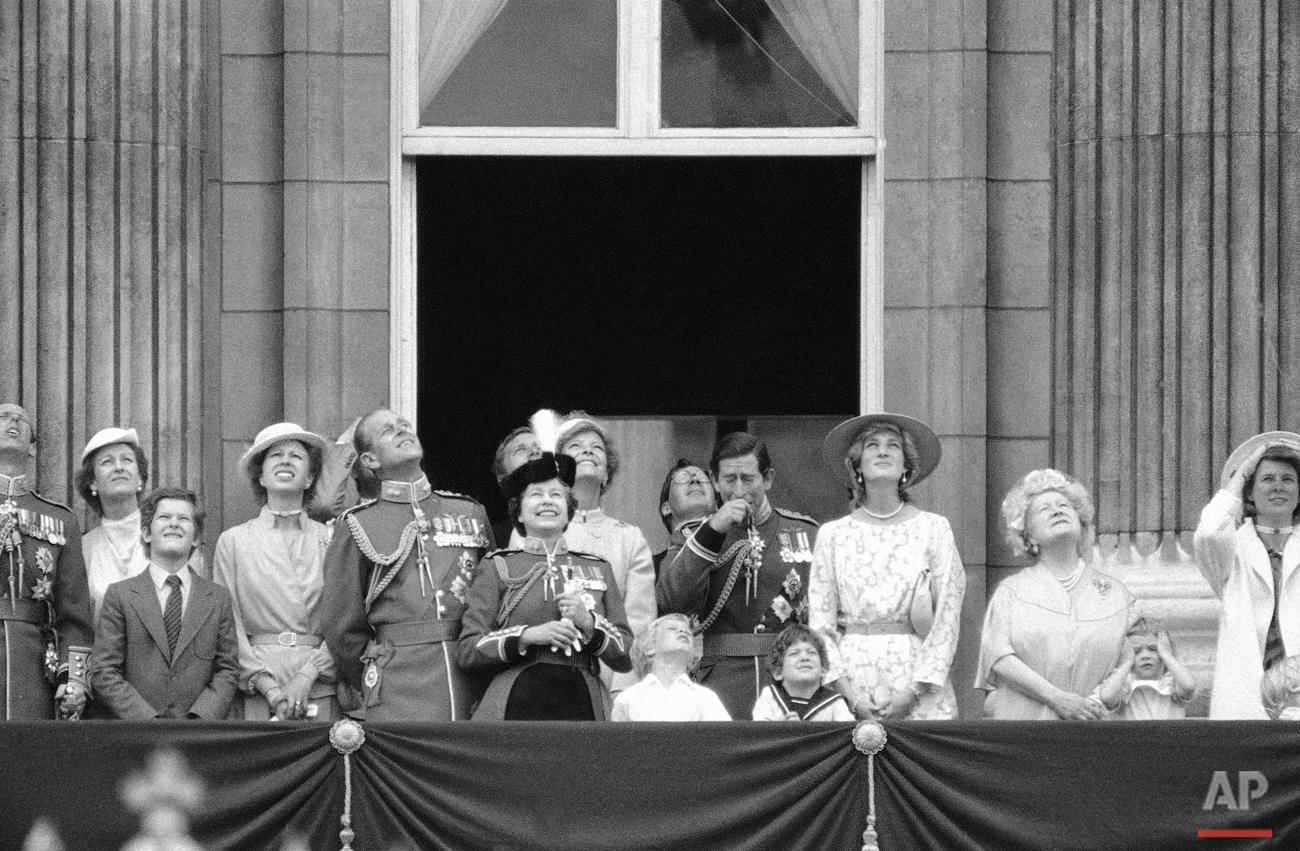 Members of the British Royal Family gathered on the balcony of London's Buckingham Palace on Saturday, June 11, 1983 watch a fly past following the Trooping of the Colour at Horse Guards parade.  Photo shows from left to right); Prince Philip, Queen Elizabeth II, Master peter Phillips (child in open neck shirt, son of Princess Anne) the Duke of Gloucester (glasses) Prince Charles (hand to face) Lord Nicholas Windsor, (sailor suit) and the Princess of Wales. (AP Photo/ Bill Foley)