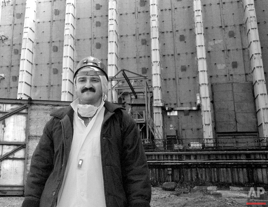 In this photo taken in 1996,  shows photographer Efrem Lukatsky, wearing protective clothes to reduce the radiation impact, standing in front of the sarcophagus that covers destroyed reactor No.4 in the Chernobyl nuclear power plant, in Chernobyl, Ukraine. The Chernobyl nuclear power plant explosion was only about 60 miles from photographer Efrem Lukatsky's home, but he didn't learn about it until the next morning from a neighbor. Only a few photographers were allowed to cover the destroyed reactor and desperate cleanup efforts, and all of them paid for it with their health. I went a few months later and have returned dozens of times.  (AP Photo)