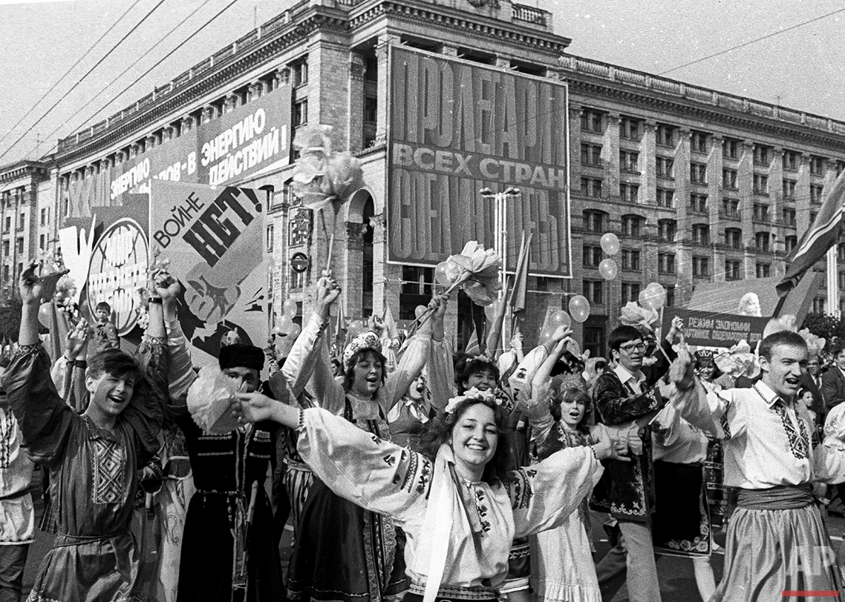 In this photo taken May 1, 1986 in Ukraine's capital Kiev, people rally to celebrate May Day a few days after the deadly explosion on the 4th unit in Chernobyl nuclear power plant. Nobody cancelled a May Day parade in Kiev when thousands of people walked in columns along the streets, with songs, flowers and Soviet leaders portraits, covered with invisible clouds of fatal radiation. (AP Photo)