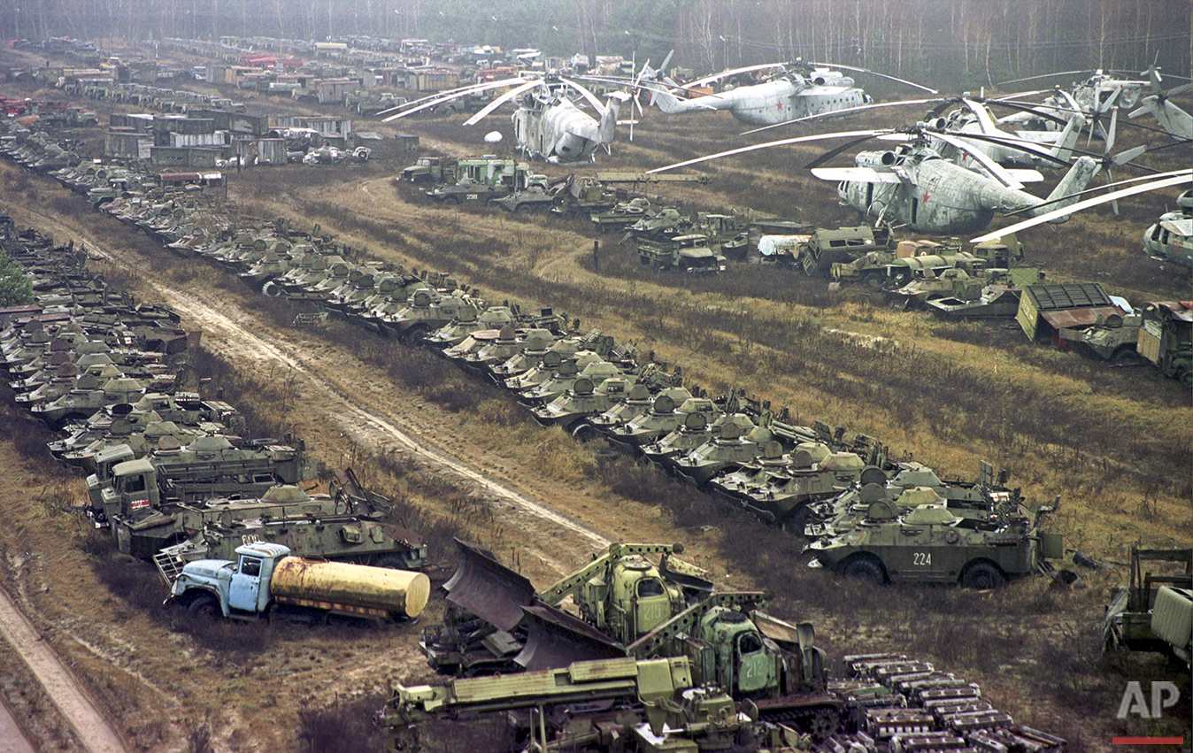 In this Nov.10, 2000 photo, radioactive contaminated vehicles lay dormant near the Chernobyl nuclear power plan. Some 1,350 Soviet military helicopters, buses, bulldozers, tankers, transporters, fire engines and ambulances were used while fighting against the April 26, 1986 nuclear accident at Chernobyl. All were irradiated during the clean-up operation. Thirty years ago, the Chernobyl Nuclear Power Plant exploded in Ukraine, spreading radioactive material across much of the Northern Hemisphere. (AP Photo/Efrem Lukatsky)