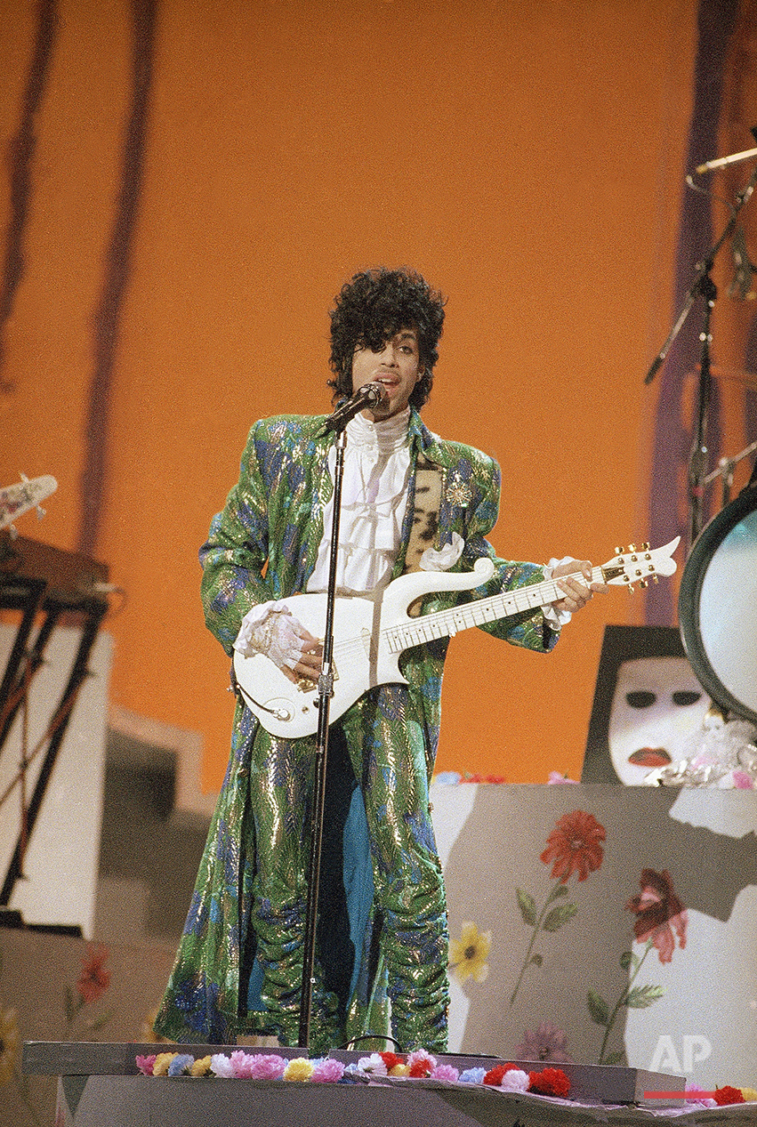Singer Prince performs at the American Music Awards in Los Angeles, Jan. 28, 1985. (AP Photo/Doug Pizac)