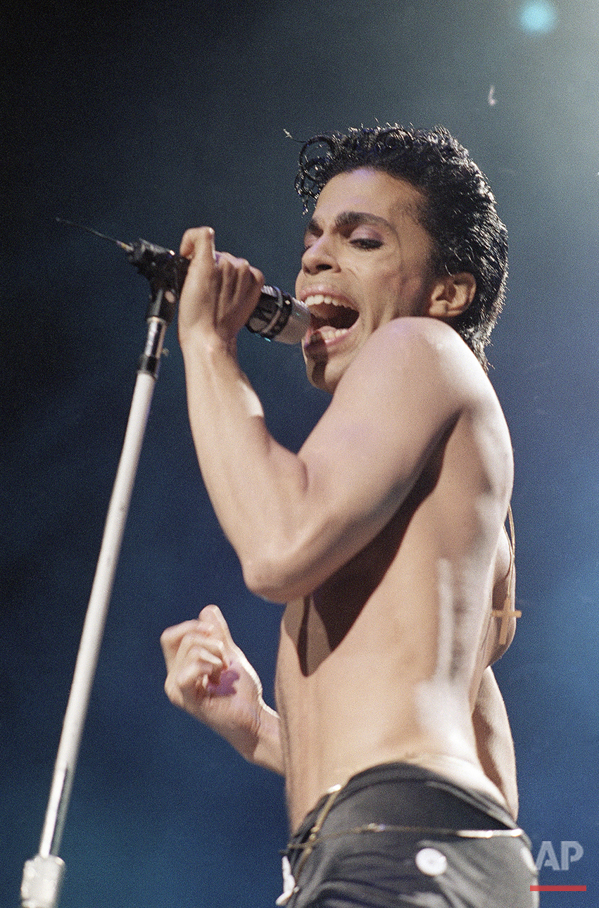 Musical artist Prince performs in concert in this August 2, 1986 file photo. Prince's songs relied more on double entendre so risque bits could fly safely over the heads of younger listeners. (AP File Photo/Mario Suriani)