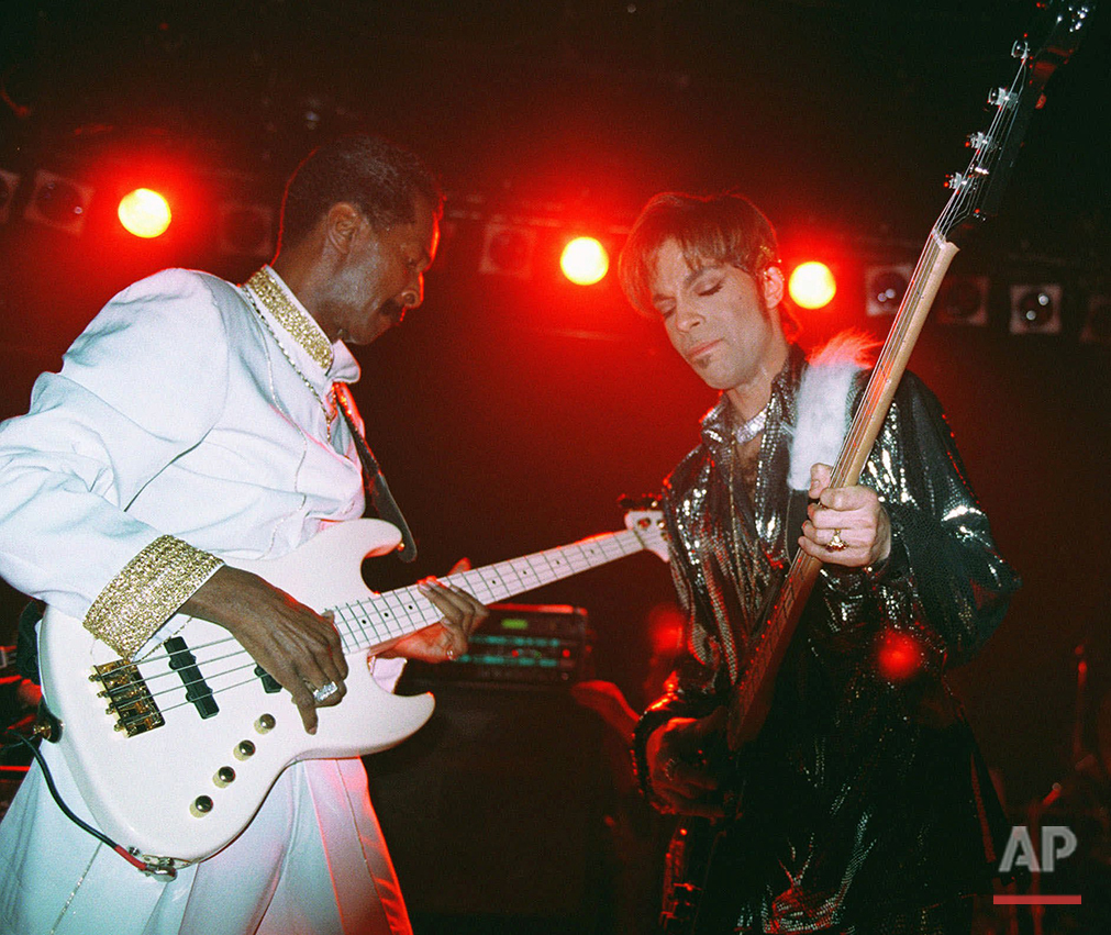 Former Sly and the Family Stone bassist Larry Grahm, left, shares the stage with The artist formerly known as Prince, during a suprise appearance at a nightclub on Friday, April 10, 1998, in New York. The Artist was honored with an award for his extraordinary musical achievements at the 1998 Essence Awards celebration in New York.  (AP Photo/Suzanne Plunkett)