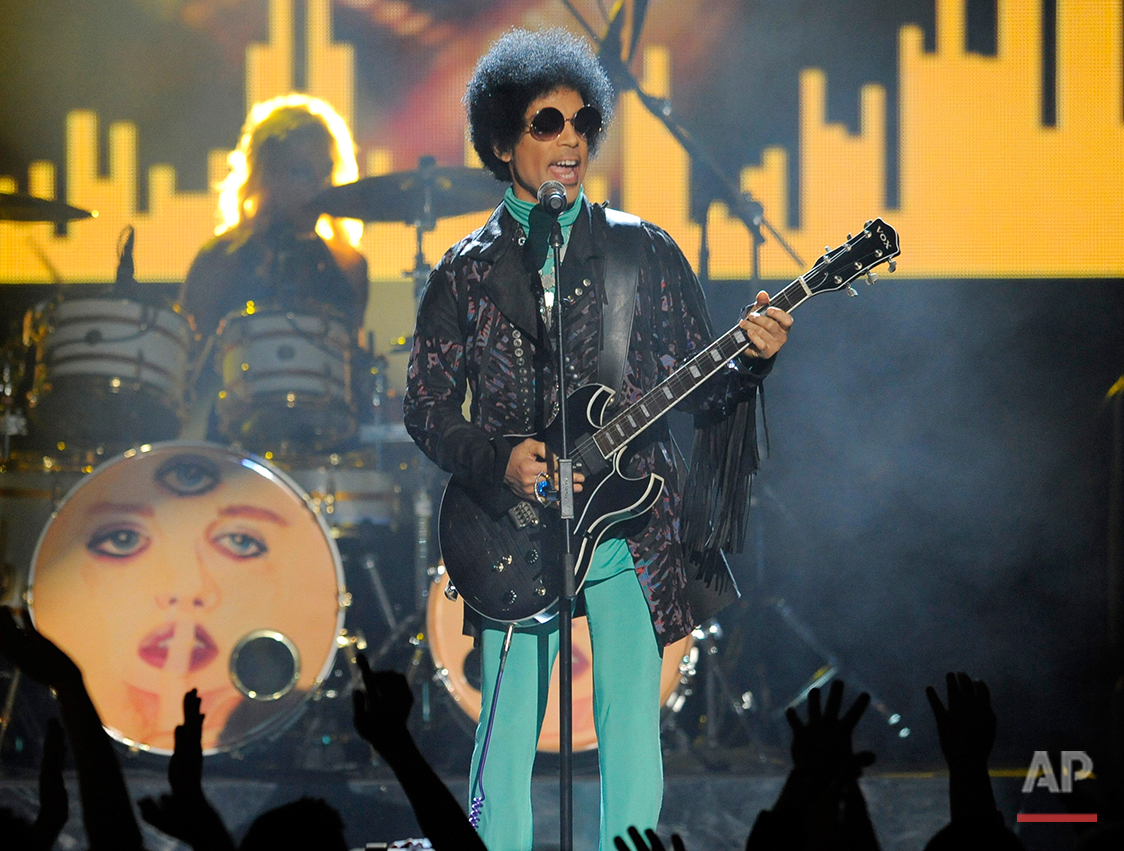 "In this May 19, 2013 photo, Prince performs at the Billboard Music Awards at the MGM Grand Garden Arena in Las Vegas. Prince, widely acclaimed as one of the most inventive and influential musicians of his era with hits including ""Little Red Corvette,"" ''Let's Go Crazy"" and ""When Doves Cry,"" was found dead at his home on Thursday, April 21, 2016, in suburban Minneapolis, according to his publicist. He was 57. (Photo by Chris Pizzello/Invision/AP)"