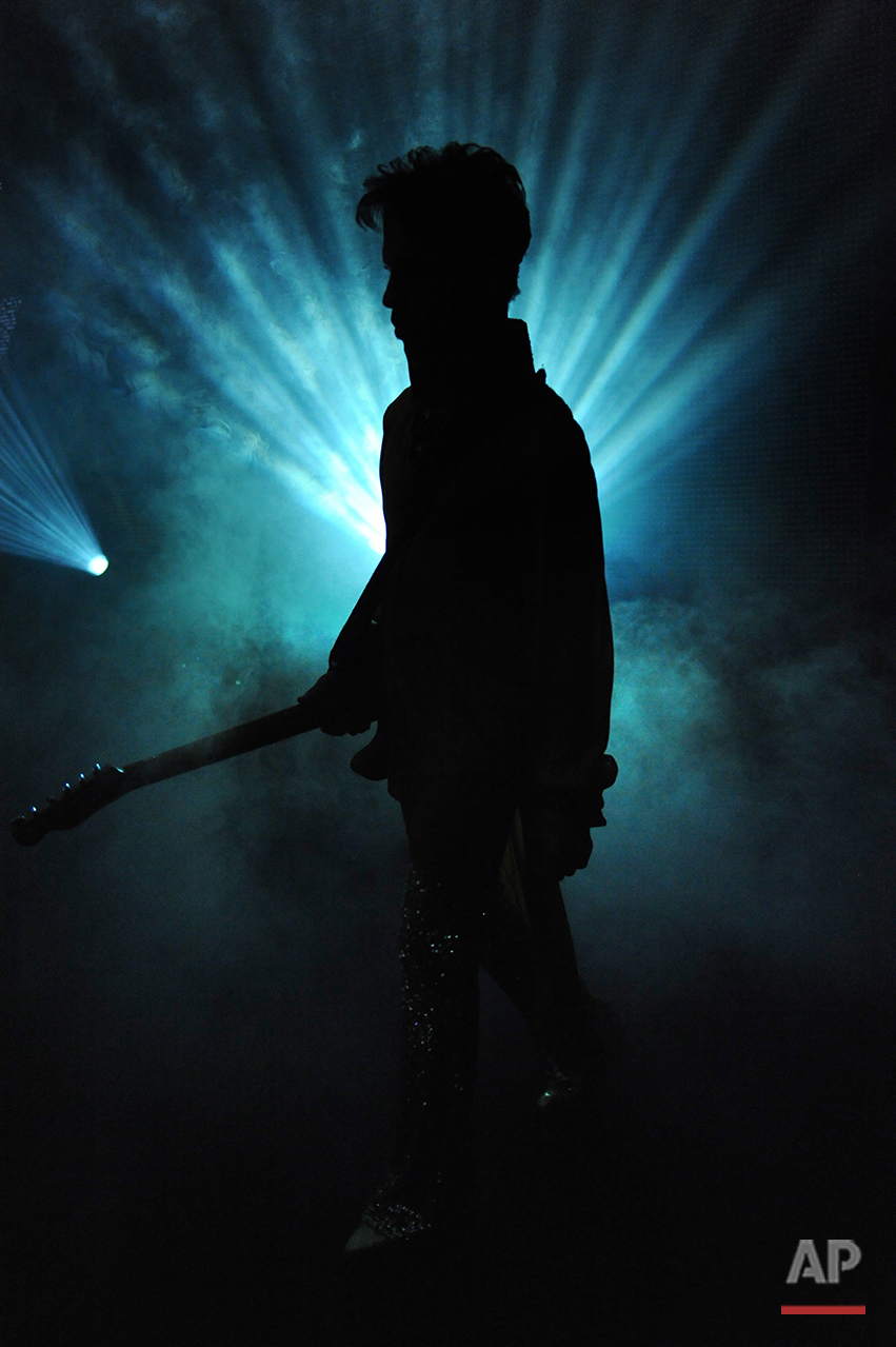 "Prince performs during his ""Welcome 2 Europe"" tour at the Umbria Jazz Festival Grounds on Friday, July 15, 2011 in Perugia, Italy. (Photo by Jordan Strauss/Invision/AP)"