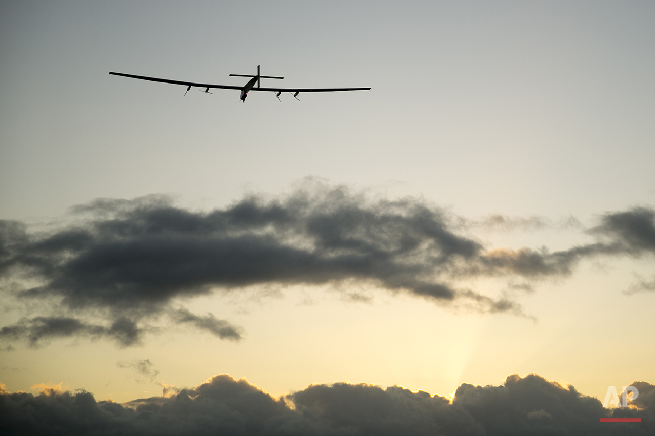 The Solar Impulse 2 solar plane flies into the sunrise out of Kalaeloa Airport, Thursday, April 21, 2016, in Kapolei, Hawaii.  The solar plane will fly a two-and-a-half day journey to Northern California.  (AP Photo/Marco Garcia)