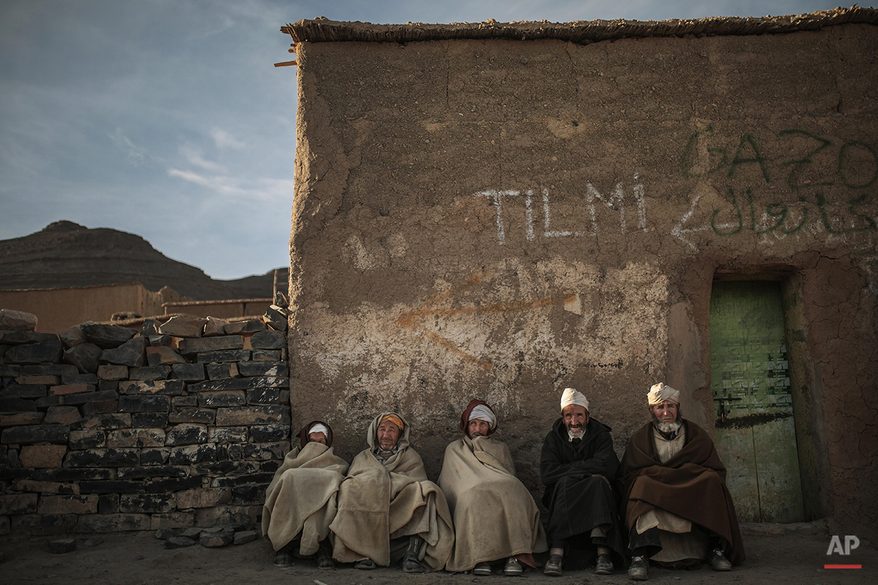 In this Thursday, Feb. 4, 2016 photo, Amazigh villagers rest as the sun sets in a village near Midelt, a town in central Morocco between the Middle and High Atlas mountains. Across North Africa, the Berbers number about 50 million. At least 15 million Moroccans are Amazigh, divided into different groups according to their dialects. While they speak the native Amazigh language of Tamazight, which has a large number of dialects and recently gained recognition as an official language in Morocco, many have adopted Arabic as part of a long process of Arabization and Islamization. (AP Photo/Mosa'ab Elshamy)