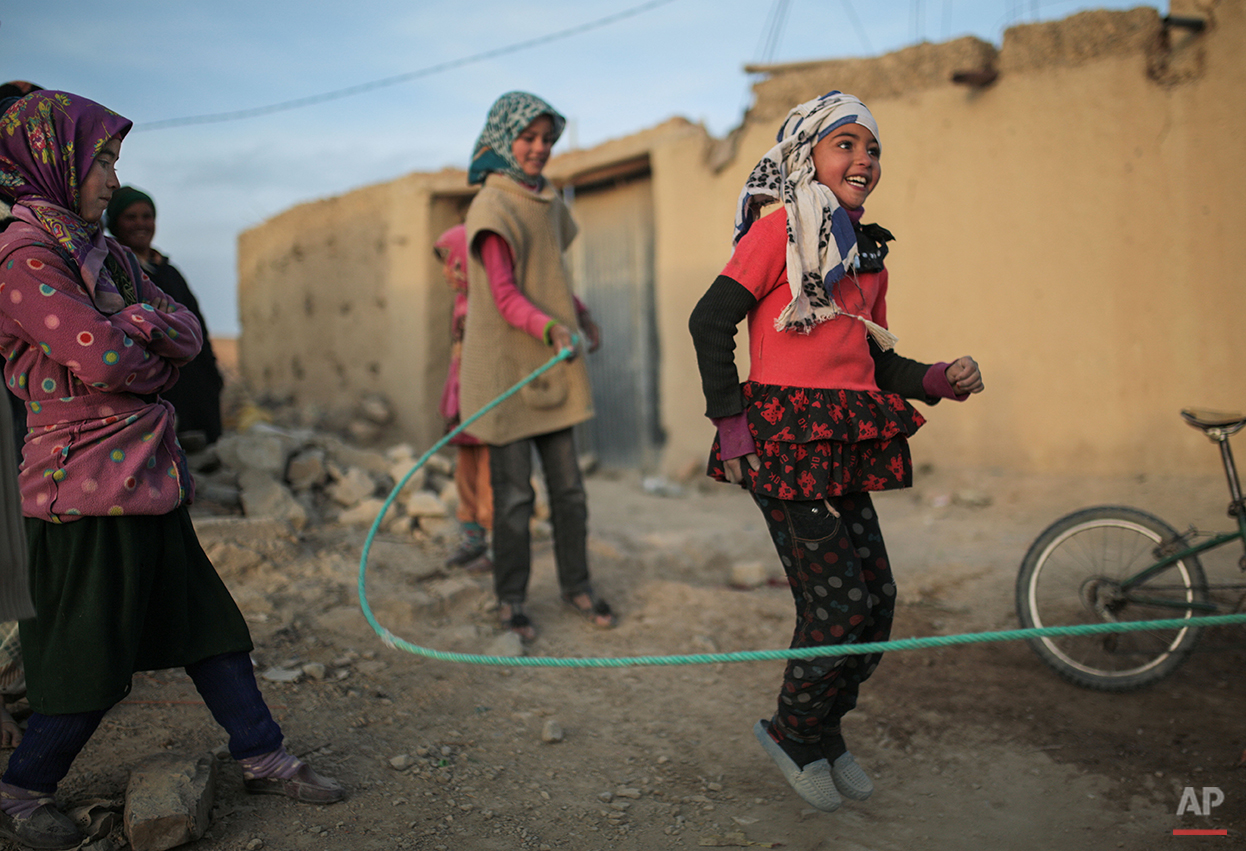 In this Thursday, Feb. 4, 2016 photo, Amazigh girls play outside their homes in a village near Midelt, a town in central Morocco between the Middle and High Atlas mountains. Across North Africa, the Berbers number about 50 million. At least 15 million Moroccans are Amazigh, divided into different groups according to their dialects. While they speak the native Amazigh language of Tamazight, which has a large number of dialects and recently gained recognition as an official language in Morocco, many have adopted Arabic as part of a long process of Arabization and Islamization. (AP Photo/Mosa'ab Elshamy)