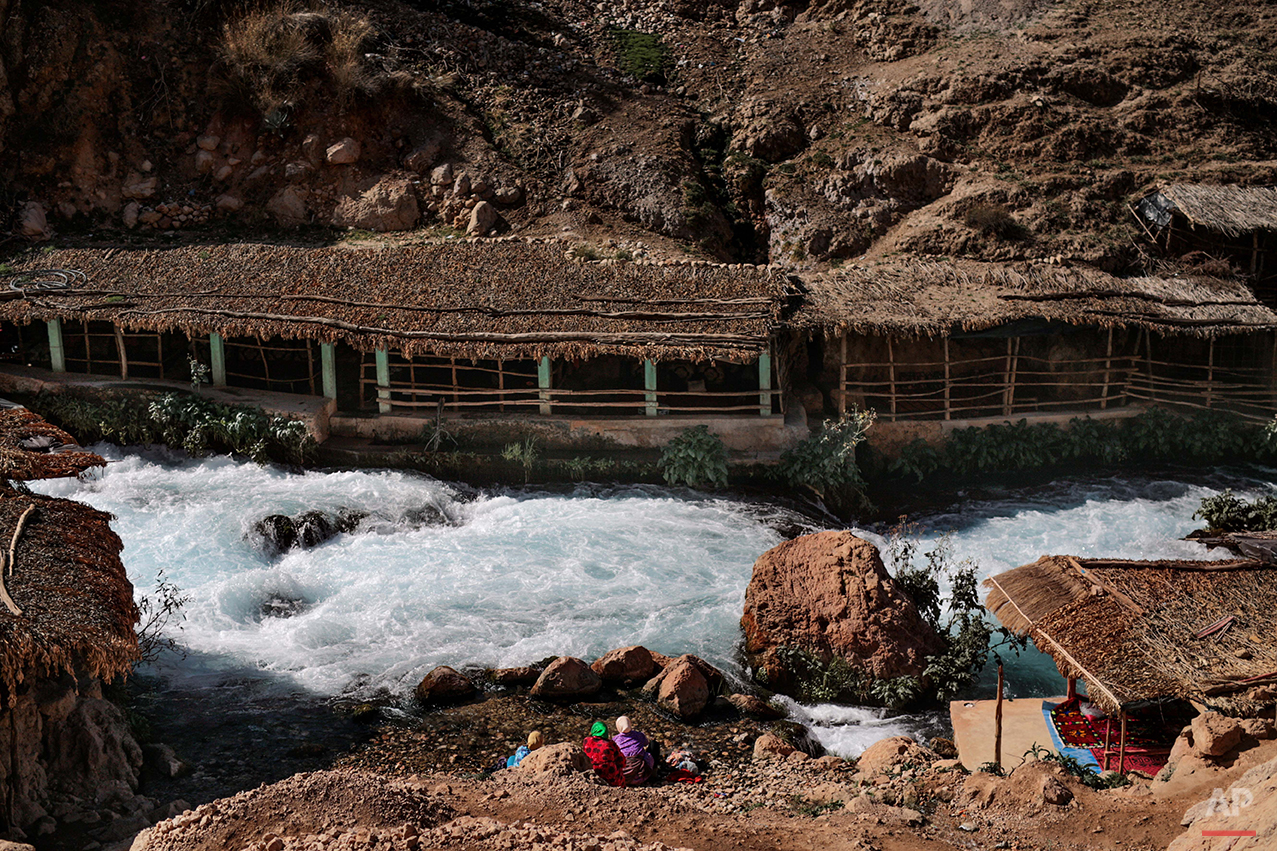 """In this Saturday, Feb. 6, 2016 photo, Amazigh women wash laundry by the Oum Rabia water springs, in Khénifra, Morocco. Indomitable and proud, they call themselves the Amazigh, which is believed to mean """"free people"""" or """"noble men,"""" and trace their origins as an indigenous people in western North Africa to at least 10,000 B.C. (AP Photo/Mosa'ab Elshamy)"""