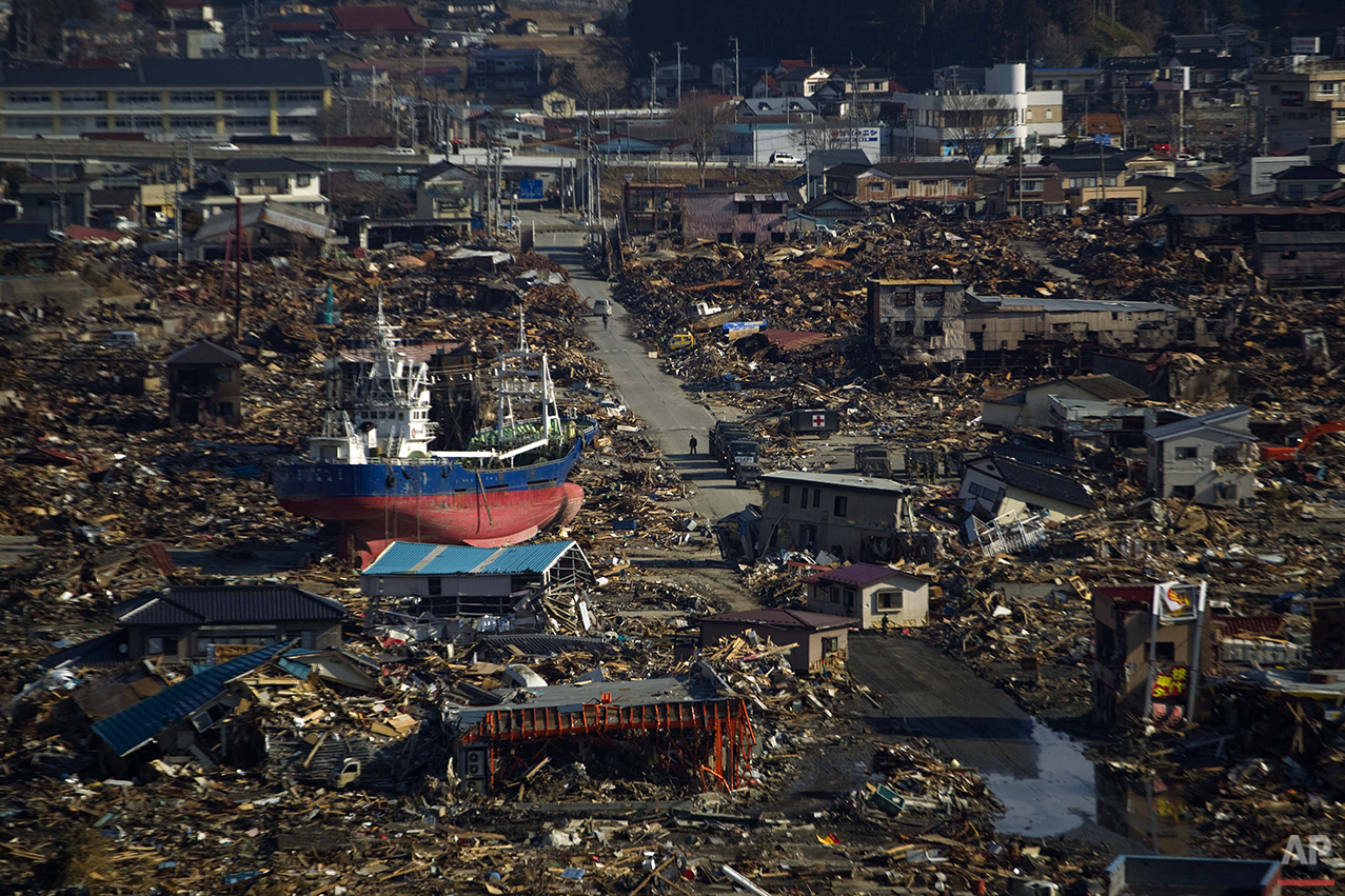 In this March 28, 2011 photo, a ship sits in a destroyed residential neighborhood in Kesennuma, Miyagi Prefecture, northeastern Japan, after a powerful tsunami hit the area on March 11. (AP Photo/David Guttenfelder)