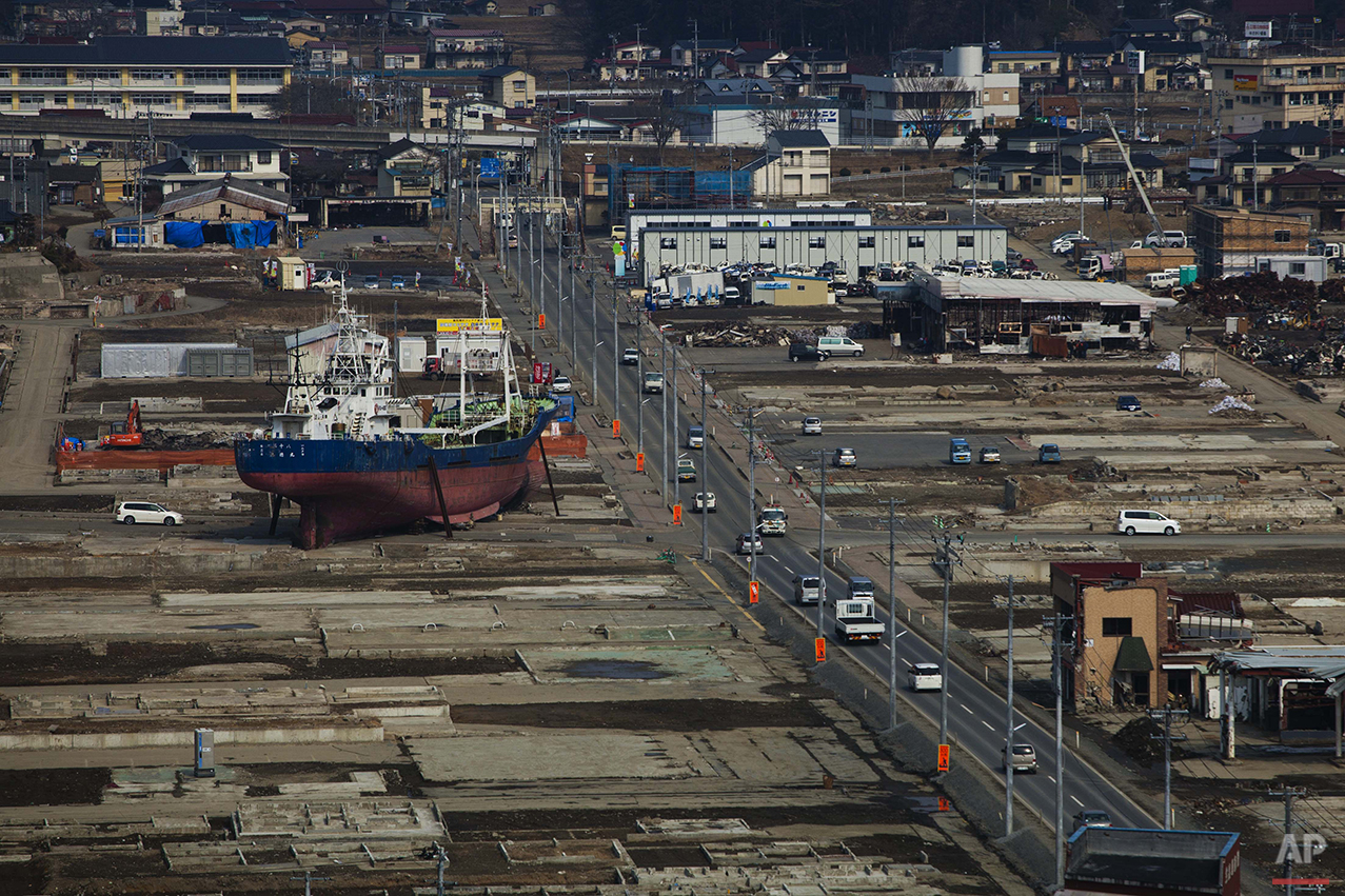 In this Feb. 23, 2012 photo, a ship sits in a destroyed residential neighborhood in Kesennuma, Japan. A year after an earthquake and tsunami ravaged the country's coastline and killed around 19,000 people, many of the boats carried inland by the wall of water have been removed. But some, like this one, remain - providing a stark reminder of nature's fearsome power. (AP Photo/David Guttenfelder)