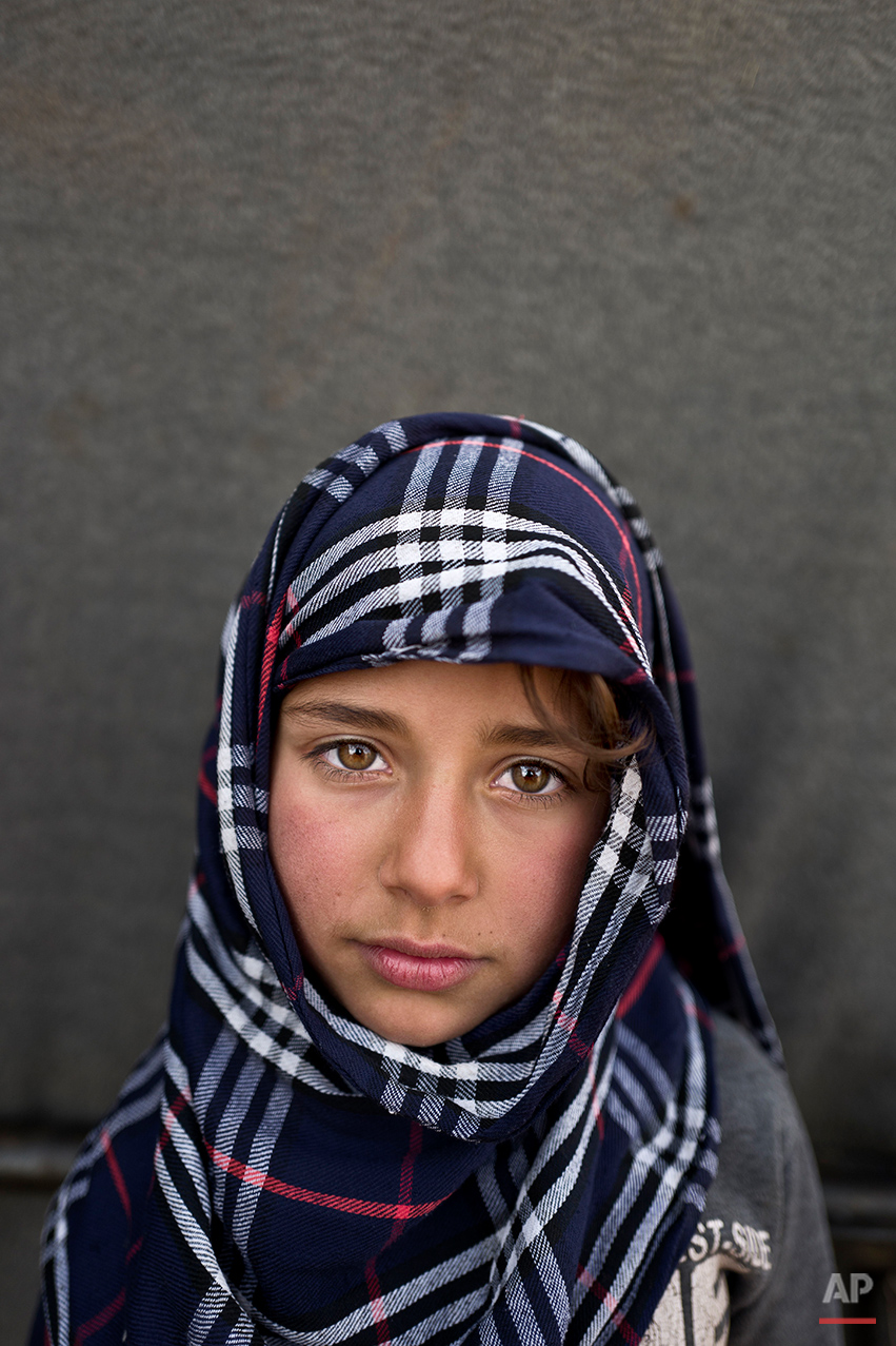 "In this Saturday, March 12, 2016 photo, Syrian refugee Hiba So'od, 6, from Hassakeh, Syria, poses for a picture at an informal tented settlement near the Syrian border on the outskirts of Mafraq, Jordan. ""I want to become a teacher,"" says So'od. (AP Photo/Muhammed Muheisen)"