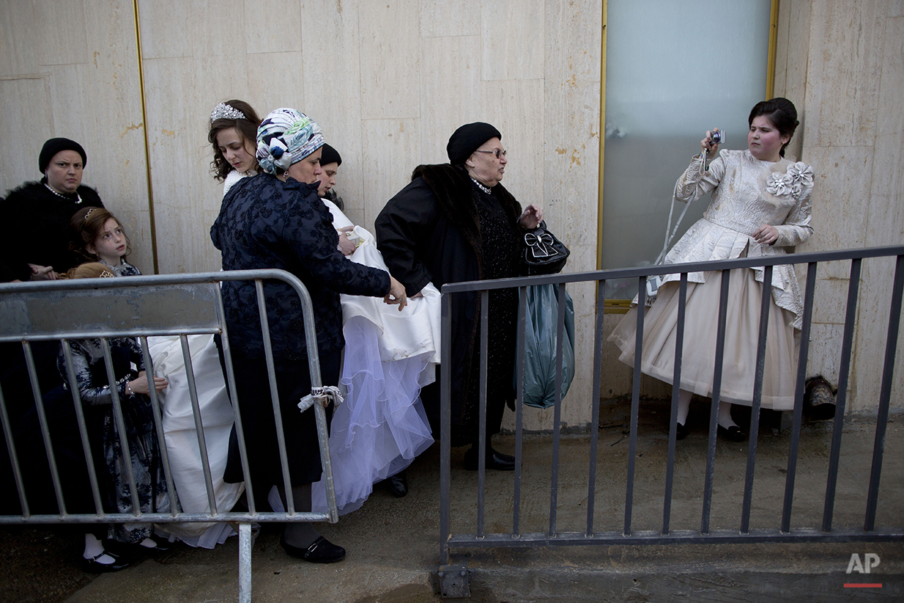 A Jewish bride arrives with family members during her wedding to the grandson of the Rabbi of the Tzanz Hasidic dynasty community, in Netanya, Israel, Tuesday, March 15, 2016. (AP Photo/Oded Balilty)