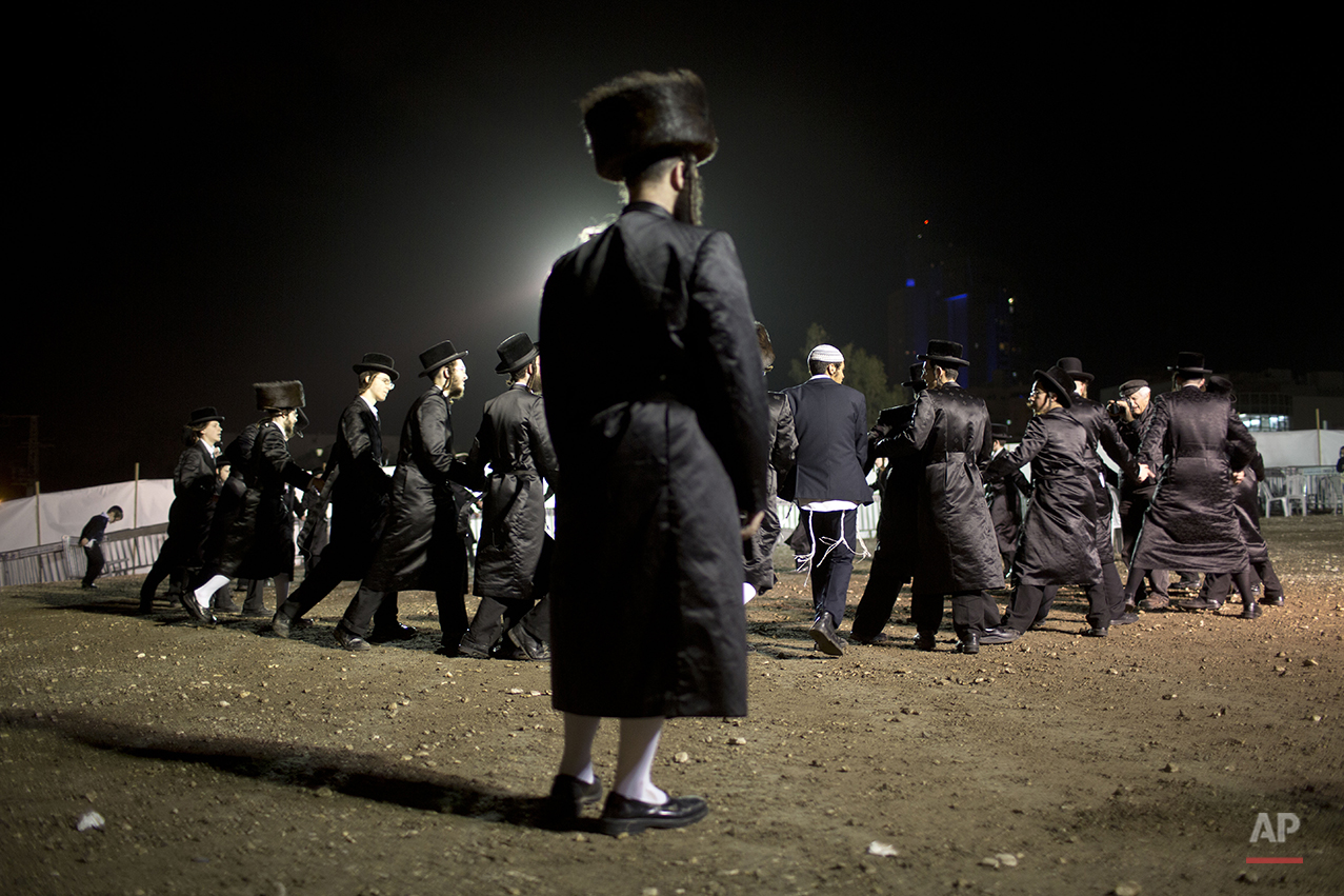 Ultra-Orthodox Jews dance in the men's section during the wedding of the grandson of the Rabbi of the Tzanz Hasidic dynasty community, in Netanya, Israel, Tuesday, March 15, 2016. (AP Photo/Oded Balilty)