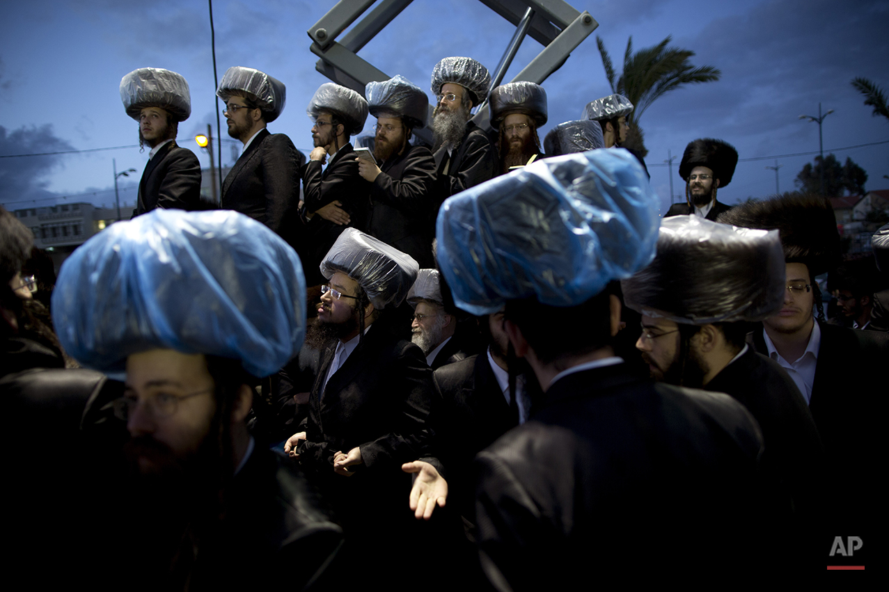 Ultra-Orthodox Jews gather in the men's section during the wedding of the grandson of the Rabbi of the Tzanz Hasidic dynasty community, in Netanya, Israel, Tuesday, March 15, 2016. (AP Photo/Oded Balilty)