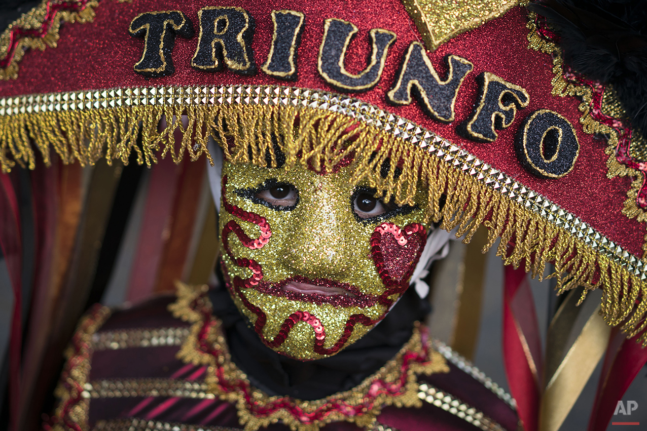 """A """"Careta"""" performer poses for a photo during Carnival in Triunfo, Brazil, Monday, Feb. 8, 2016. Far from the glitz and glamour of Rio de Janeiro's famous Sambadrome parades, people in this northeast Brazilian town put a frown on their Carnival celebration. (AP Photo/Felipe Dana)"""