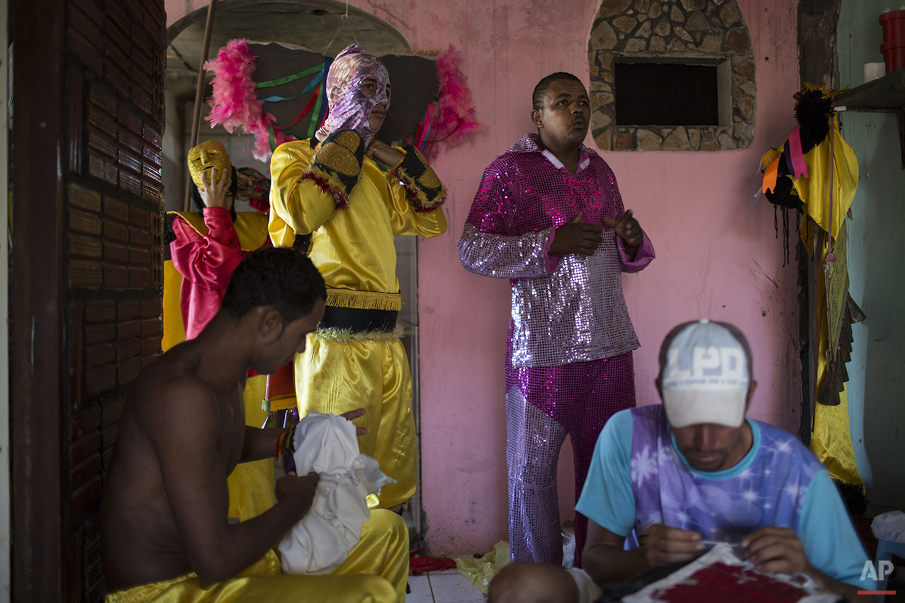 """""""Caretas"""" performers put on their hand-made costumes before parading at Carnival festivities in Triunfo, Brazil, Monday, Feb. 8, 2016. This town's carnival is far from the glitz and glamour of Rio de Janeiro's famous Sambadrome parades. (AP Photo/Felipe Dana)"""