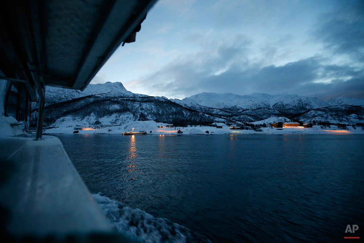 In this photo taken Tuesday, Feb. 2, 2016, the morning ferry arrives at the island of Seiland, northern Norway, where a number of asylum seekers are housed in temporary accommodation at the Altnes camp. Waiting for their asylum claims to be processed, hundreds of people in emergency shelters in Hammerfest and neighboring towns are slowly getting used to the extreme climate and unfamiliar customs of the High North.  (AP Photo/Alastair Grant)