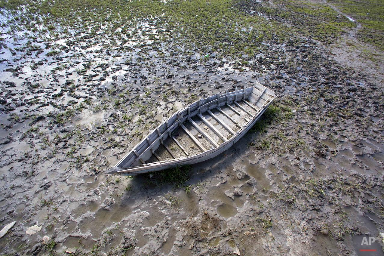 In this Feb. 20, 2016 photo, a boat sits near Lake Azuei in Thomazeau, Haiti. ( AP Photo/Dieu Nalio Chery)