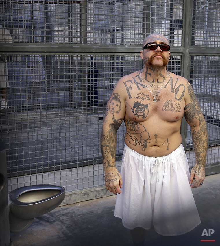 In this photo taken on Tuesday, Dec. 29, 2015, inmate Robert Galvan stands in a cell in the recreation yard at San Quentin State Prison in San Quentin, Calif. With California's lethal injection protocol in limbo, the nearly 750 inmates at San Quentin State Prison, the nation's most populous death row, are more likely to die from natural causes or suicide than execution. The inmates await a final decision on a proposed one-drug execution method to replace a three-drug method that a federal judge invalidated in 2006 as a potentially cruel and unusual punishment. (AP Photo/Ben Margot)
