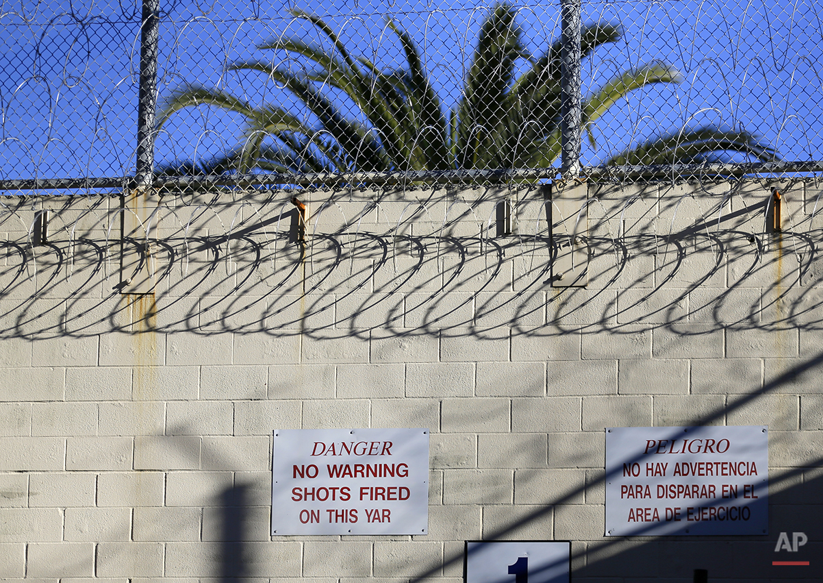 In this photo taken on Tuesday, Dec. 29, 2015, a sign warning that no warning shots will be fired is seen on a recreation yard near death row at San Quentin State Prison in San Quentin, Calif. With California's lethal injection protocol in limbo, the nearly 750 inmates at San Quentin State Prison, the nation's most populous death row, are more likely to die from natural causes or suicide than execution. (AP Photo/Ben Margot)