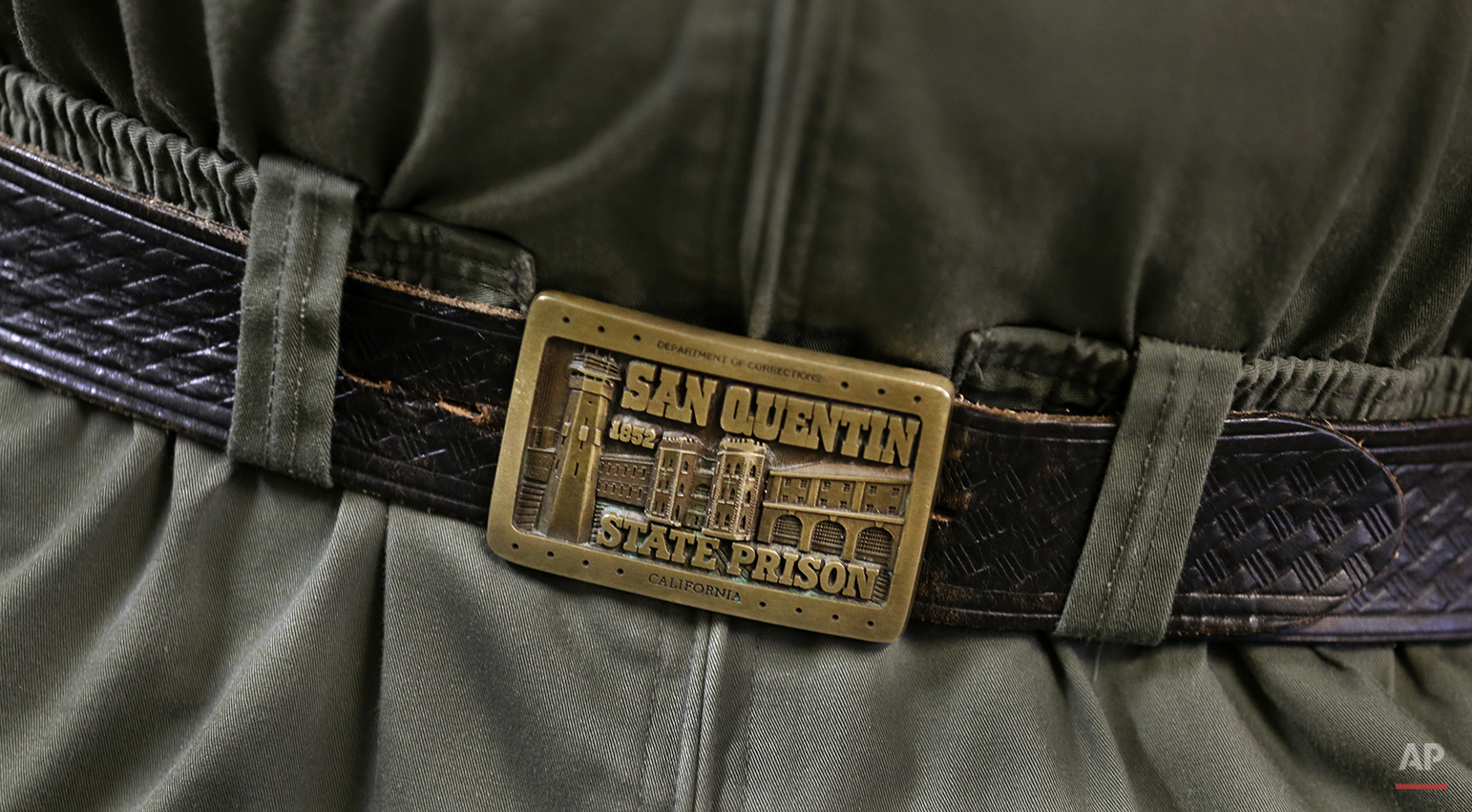 In this photo taken on Tuesday, Dec. 29, 2015, a belt buckle warn by a San Quentin State Prison officer is seen at in San Quentin, Calif. With California's lethal injection protocol in limbo, the nearly 750 inmates at San Quentin State Prison, the nation's most populous death row, are more likely to die from natural causes or suicide than execution. (AP Photo/Ben Margot)