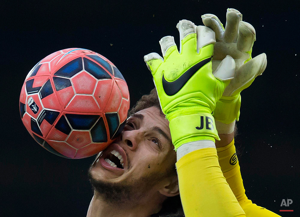 In this Saturday, Feb. 14, 2015 photo, Blackburn's Rudy Gestede, left, in action against Stoke's goalkeeper Jack Butland during the English FA Cup fifth round soccer match between Blackburn and Stoke at Ewood Park Stadium, Blackburn, England. (AP Photo/Jon Super)