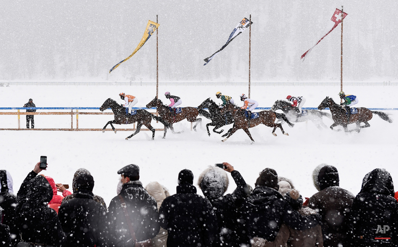 In this Feb. 15, 2015 photo, eventual winner Fox Kieren rides Berrahri, far left, as he competes during the GP Christoffel Bau Trophy on the frozen Lake St. Moritz on the second weekend of the White Turf races in St. Moritz, Switzerland. (Gian Ehrenzeller/Keystone via AP)