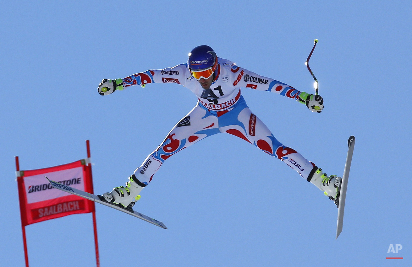 In this Feb. 20, 2015 photo, Adrien Theaux, of France, is airborne during a men's World Cup downhill training session, in Saalbach Hinterglemm, Austria. (AP Photo/Giovanni Auletta, file)