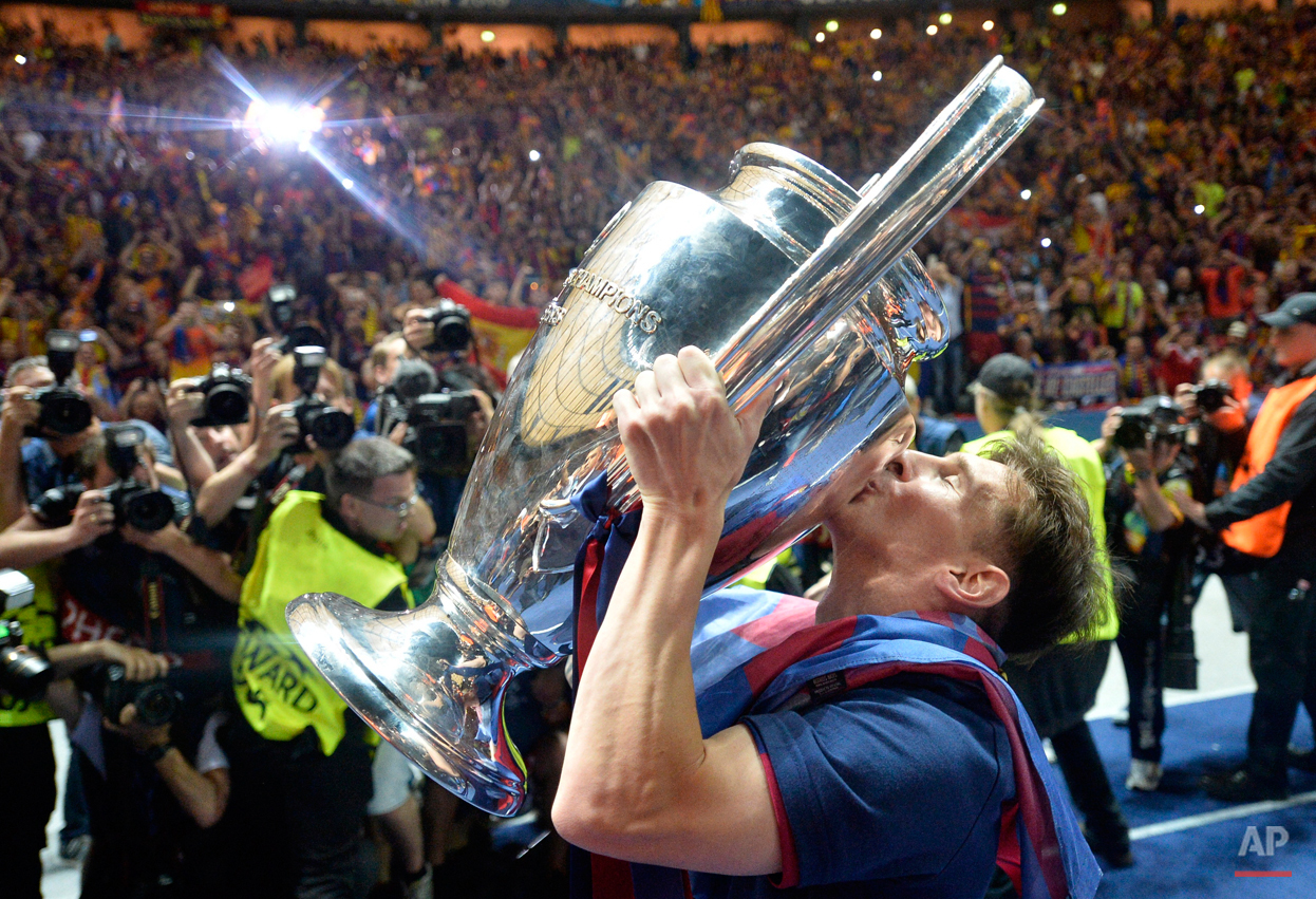 In this June 6, 2015 file photo Barcelona's Lionel Messi kisses the trophy after his team won 3-1 in the Champions League final soccer match between Juventus Turin and FC Barcelona at the Olympic stadium in Berlin. (AP Photo/Martin Meissner)