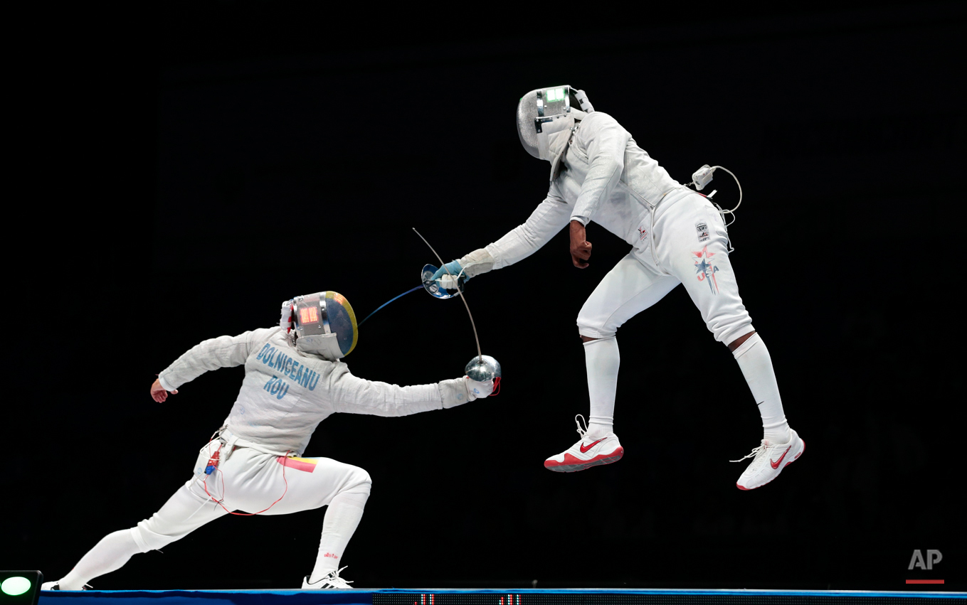 In this July 14, 2015 photo Tiberiu Dolniceanu, of Romania, left, and Daryl Homer, of the United States, right, in action during their semifinal match at sabre competition at the fencing World championships in Moscow, Russia. (AP Photo/Ivan Sekretarev)