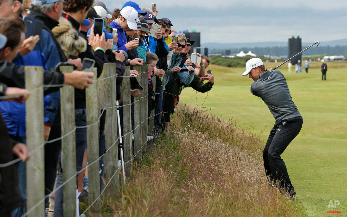 In this Wednesday, July 15, 2015 photo, United States' Jordan Spieth plays from the rough on hole 16 during a practice round at the British Open Golf Championship at the Old Course, St. Andrews, Scotland. (AP Photo/David J. Phillip)