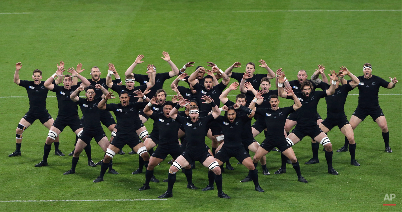 In this Oct. 9, 2015 photo, New Zealand players perform the haka before their Rugby World Cup Pool C match between New Zealand and Tonga at St James' Park, Newcastle, England.  (AP Photo/Scott Heppell)